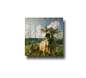 Image sur lames en bois praire avec des vaches