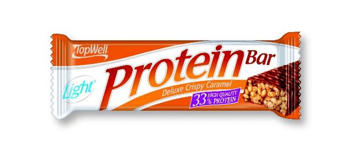 Deluxe Protein Bar Barre protéinée Top Well 471920700100 Goût CRISPY-KARAMEL Photo no. 1